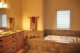 Nicklaus House master bathroom with Jacuzzi tub and vanity